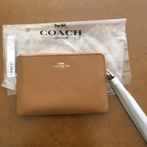 Coach camel colored wristlet New with tags